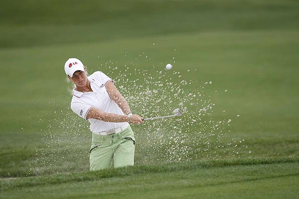 Suzann Pettersen, who double-bogeyed the fifth hole, is also at one under par.