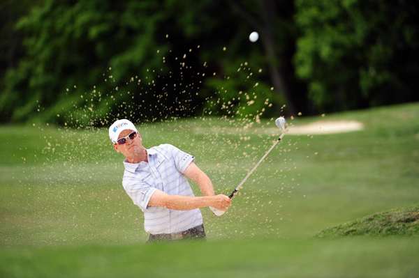 Zach Johnson rebounded from two early bogeys to shoot a 68, and he finished with a two-shot lead.