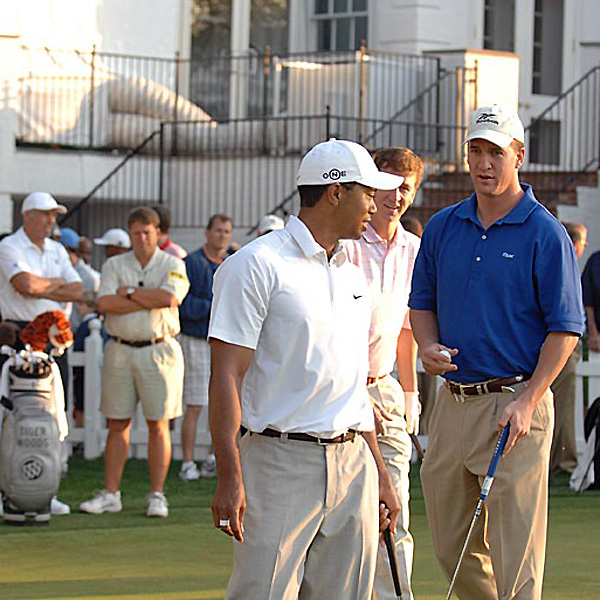 Before his practice round, Woods chatted with the Manning brothers, Peyton and Cooper.