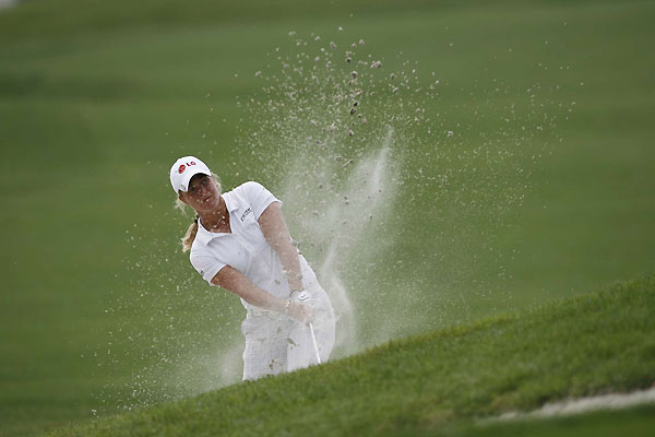 Suzann Pettersen made four birdies on the back nine to shoot a 65.