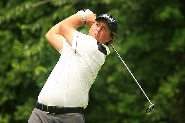 Defending champion Phil Mickelson is four strokes off the lead after an opening-round 70.
