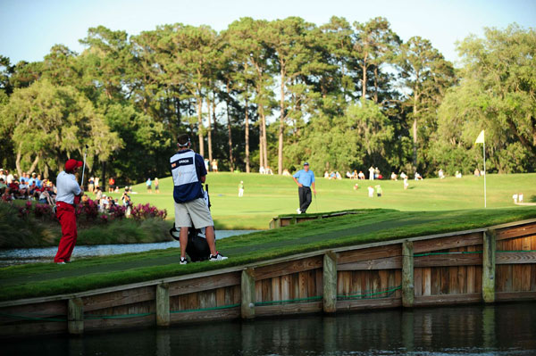 Garcia's tee shot on 17 trickled off the back of the green and continued down the foot path. His awkward chip shot landed on the green, but kept rolling, and stopped inches away from dropping into the water. Garcia finished with a double bogey on the hole.