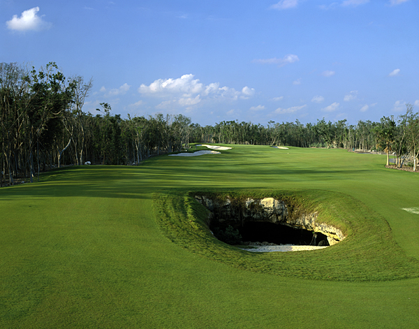 "El Camaleon at the Fairmont Mayakoba, Playa del Carmen, Riviera Maya, Mexico                       At the first PGA Tour event ever held in Mexico, leader Fred Funk's final round was nearly dashed when his first drive of the day finished near the lip of a hazard. It wasn't just any hazard, however. This was the ""Devil's Mouth,"" the opening to a gaping cenote, an underground, freshwater cave that monopolizes the middle of the fairway. Funk recovered and won the event, but not before dueling with limestone-lined canals that bisect the layout, jungle-like mangrove swamps, natural rock caverns and the Caribbean Sea at this Greg Norman design, that's as much fun for spelunkers as it is for golfers."