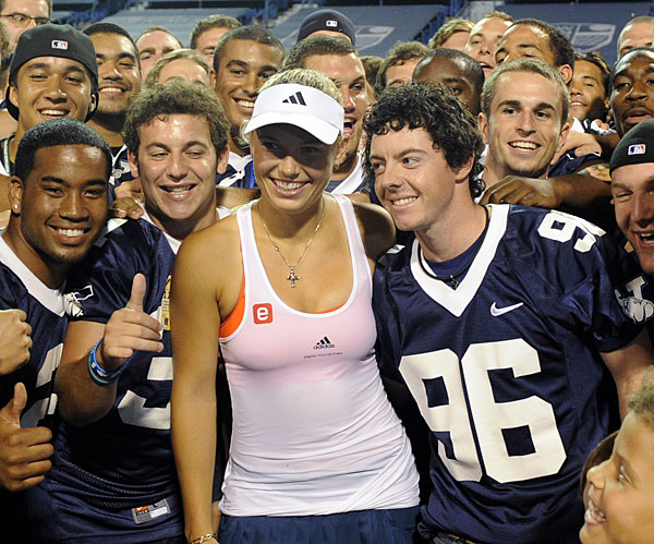 McIlroy stepped out with tennis star girlfriend Caroline Wozniacki later in the summer. Here he celebrates with the Yale football team after Wozniacki's semifinal win at the 2011 New Haven Open.