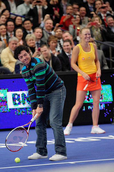"Before the match, Wozniacki invited McIlroy to come on the court where he ""served"" to Sharapova."