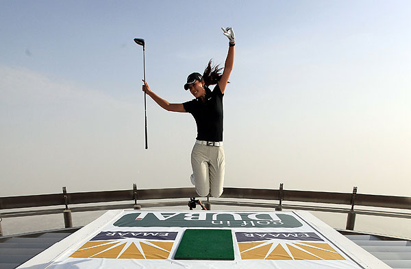 In Dubai for the Dubai Ladies Masters, Michelle Wie took a swing from the 'At the Top Burj Dubai' viewing platform. The platform is on the 124th floor on the world's tallest building Burj Dubai.