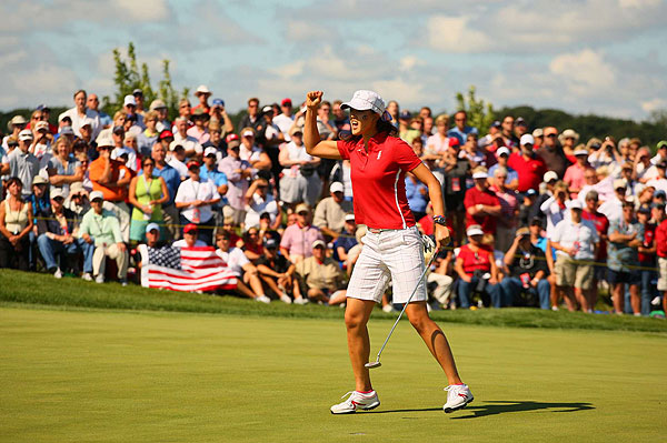 Michelle Wie continued her strong Solheim play by winning her match against Helen Alfredsson.