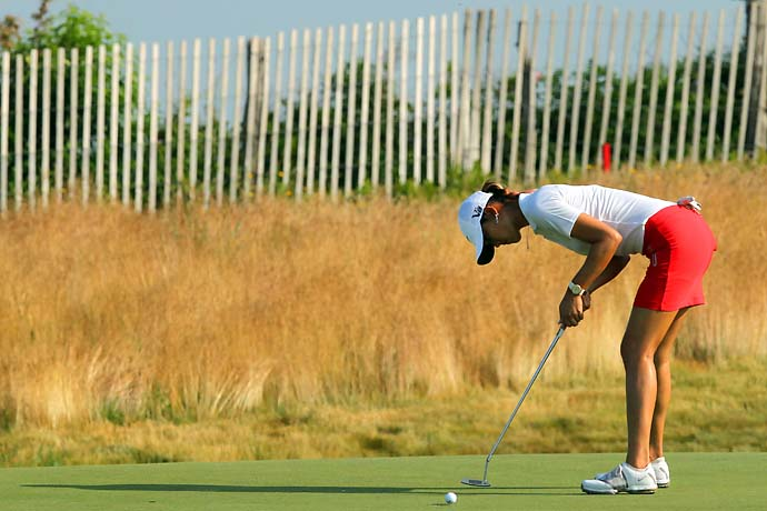 Michelle Wie putts on the 11th green during the first round of the U.S. Women's Open at Sebonack Golf Course.