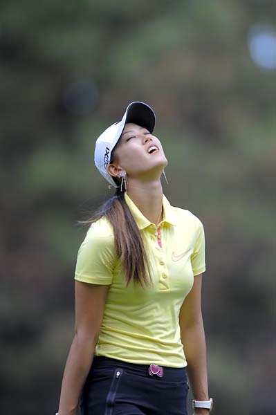 Michelle Wie reacts to a bad shot during the second round of the ISPS Handa Australian Open at the Royal Canberra Golf Club in Canberra, Australia, Feb. 15, 2013.