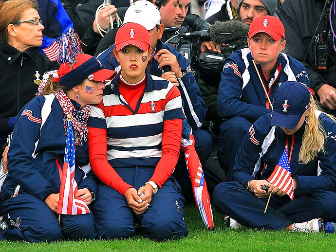 Paula Creamer, Michelle Wie and Stacy Lewis look on sadly during the singles matches on day three of the 2011 Solheim Cup at Killeen Castle Golf Club in Dunshaughlin, County Meath, Ireland. Europe defeated the US 15-13.