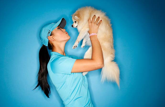Michelle Wie poses for a portrait with her Pomeranian, Lola, on March 22, 2011 at the Industry Hills Golf Club in the City of Industry, Calif.