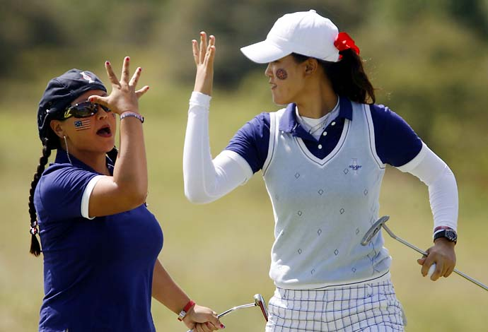 Michelle Wie and Christina Kim celebrate on the ninth green during their fourballs match on the second day of the 2009 Solheim Cup golf tournament at Rich Harvest Farm in Sugar Grove, Illinois, Aug. 22, 2009.