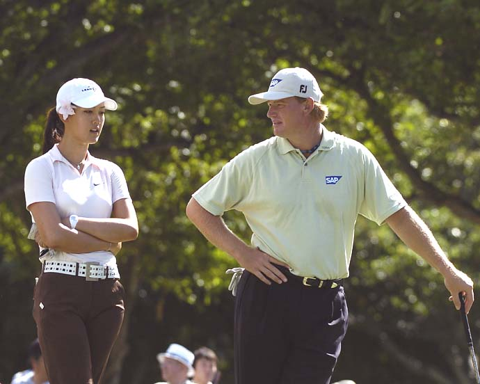 Michelle Wie and Ernie Els tee off in the 2005 Sony Open Pro-Am at Waialae Country Club Jan. 12, 2005.  (Photo by Al Messerschmidt/Getty Images)