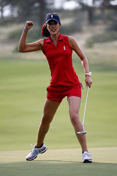 Michelle Wie reacts to making a putt on the 14th hole during the afternoon Four-Ball matches for the 2013 Solheim Cup on August 2013