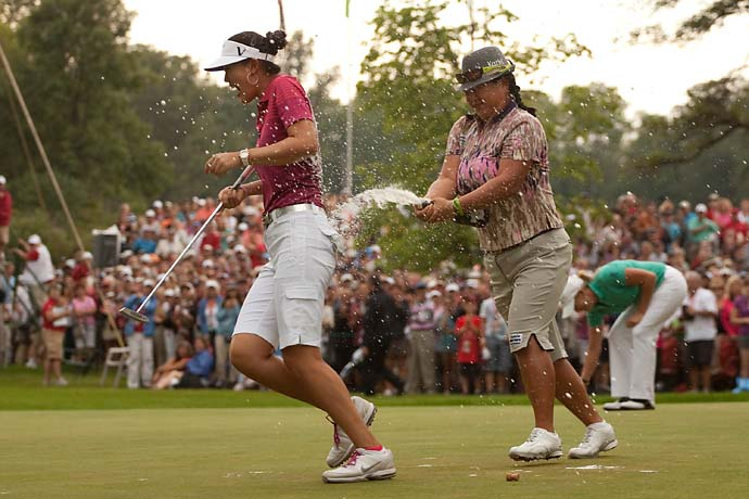 Michelle Wie celebrates her win at the 2010 Canadian Open with her good friend and fellow LPGA Tour player Christina Kim.