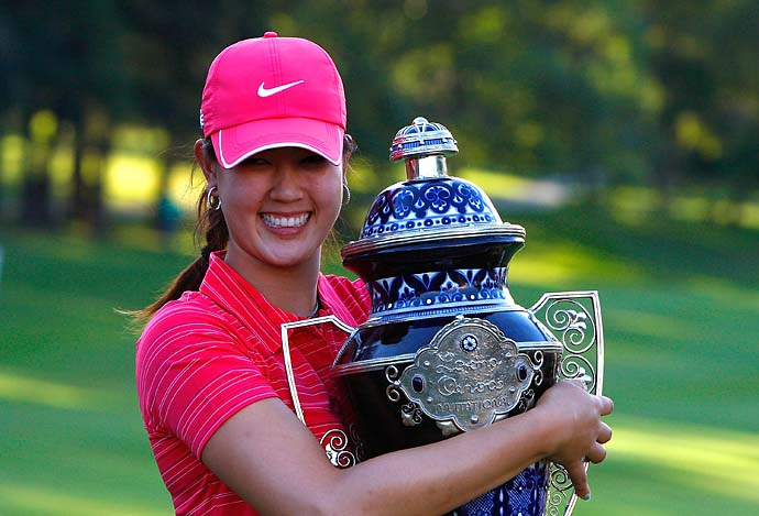 Michelle Wie hold on tight to her trophy after winning the Lorena Ochoa Invitational at Guadalajara Country Club on Nov. 15, 2009 in Guadalajara, Mexico.