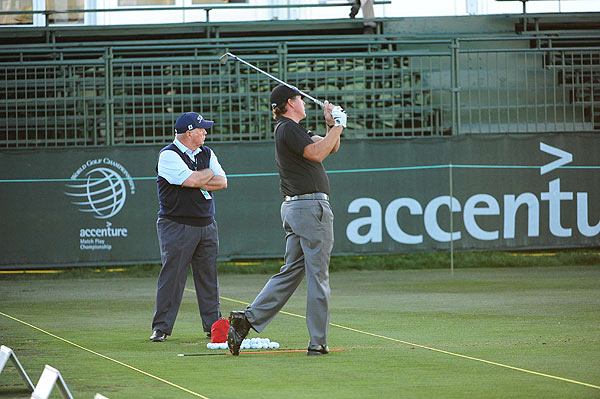 Phil Mickelson beat Tiger Woods to the range, where he worked with his swing coach Butch Harmon for more than an hour.
