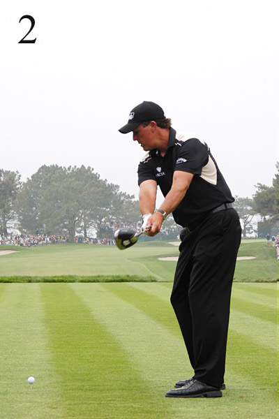 2. Phil's takeaway has gotten much better. It used to be inside, forcing his club across the line much earlier and more severely at the top. While the club looks slightly outside his hands, it's lined up parallel to his feet. So far, so good.