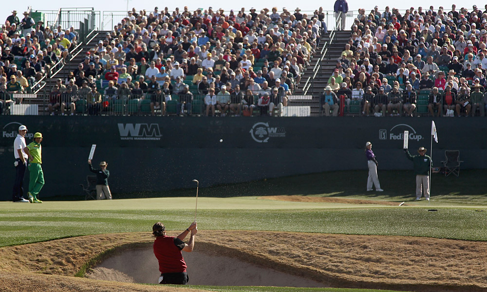 Mickelson missed the green on the infamous 16th hole but went up-and-down to save par.