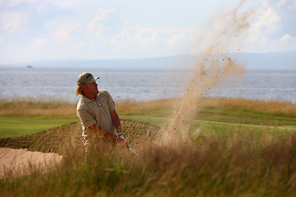 First round at Turnberry                       Miguel Angel Jimenez birdied the final hole Thursday, closing with a six-under 64, to move one stroke ahead of early leaders Tom Watson and Ben Curtis.