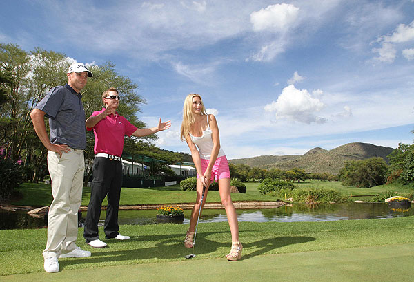 Hunter Mahan and Nick Watney helped Miss America, Lisa-Marie Stephanie Kohrs, with her golf game during the Nedbank Golf Challenge pro-am last week.