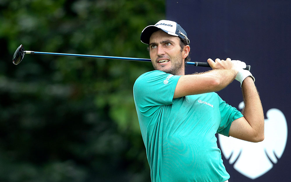 Edoardo Molinari made it through 10 holes before play was suspended due to rain. He is tied for the lead with James Morrison, who shot a 68.
