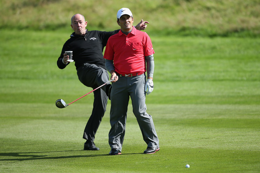 Denis Pugh, left, pretended to kick Francesco Molinari at the Johnnie Walker Championship.