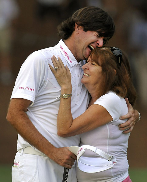 Bubba Watson hugs his mother Molly Watson after sinking his putt during a playoff against Louis Oosthuizen to win the 76th Masters on April 8, 2012.