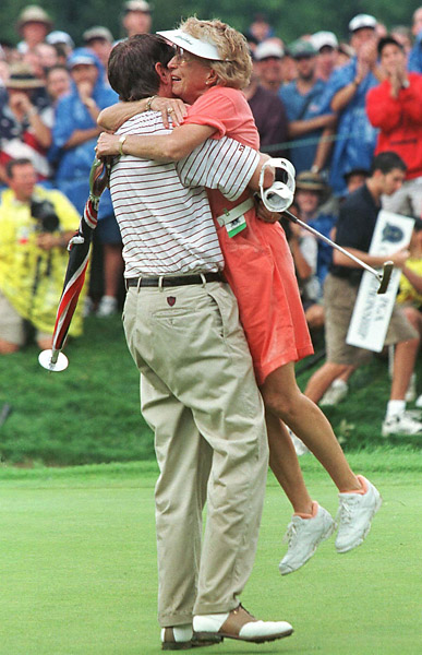 Davis Love III lifts his mother Penta Love off the 18th green after capturing his first major championship with a win at the 79th PGA Championship at the Winged Foot Golf Club in Mamaroneck in 1997.
