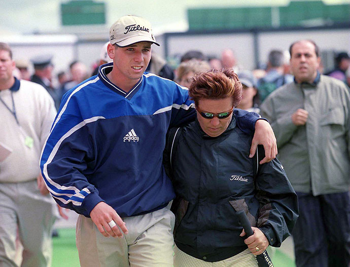 Sergio Garcia walks off with his mother, Consuelo, after the first round at the British Open Championship, Carnoustie, Scotland on July 15, 1999.