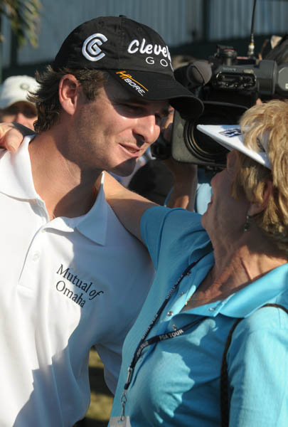 Kevin Streelman is congratulated by his mother, Mary Lou Streelman, after finishing the second round of the Children's Miracle Network Classic at Walt Disney World in Lake Buena Vista, Fla., Nov. 13, 2009.  Streelman made a birdie on the 17th hole to win a $1 million bonus by winning the Kodak Challenge prize.