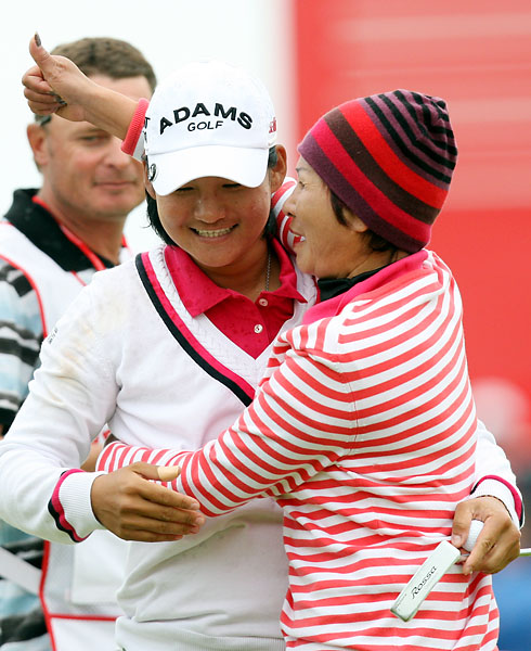 Yani Tseng celebrates with her mother after winning the Women's British Open at Carnoustie Golf Club, Carnoustie, Scotland, on July 31, 2011.