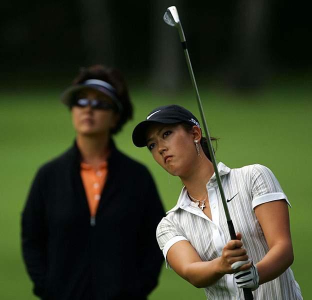 Bo Wie watched Michelle during a practice round at the 2006 Sony Open.