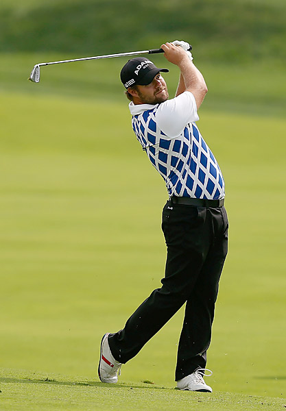 Ryan Moore also shot a 66 to finish at 12 under.