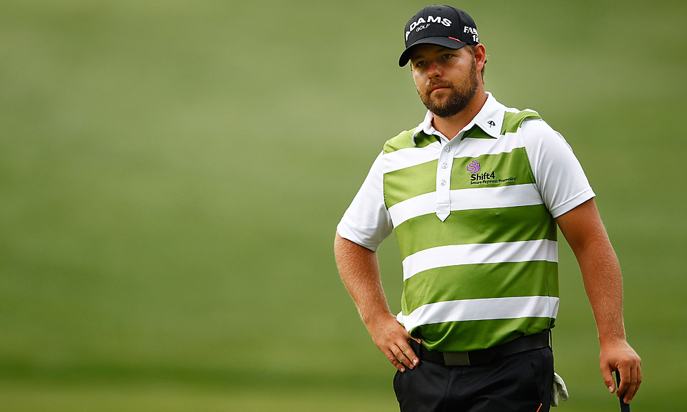 During the second round of the Wells Fargo Championship, Ryan Moore addressed his 10-inch par putt on the 11th hole, only to watch his ball move slightly before he hit it. Despite a 2011 rules change that determined there is no penalty if a ball is moved by an outside agency, like the wind, the rules official decided that no outside agency had caused the movement. Moore was assessed a one-shot penalty and lost by three shots.