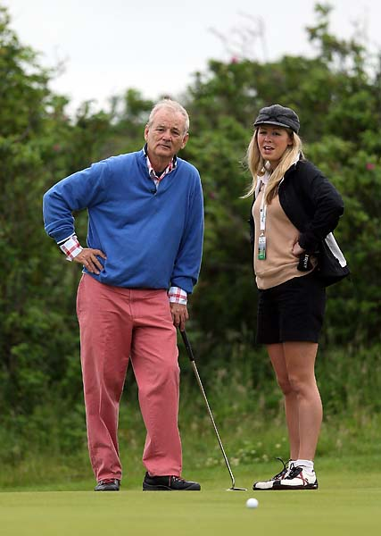Bill Murray talks about his putt with caddie Keri Smyth  during the pro-am for the 2012 Irish Open held on the Dunluce Links at at Royal Portrush Golf Club in June 2012 in Portrush, Northern Ireland.