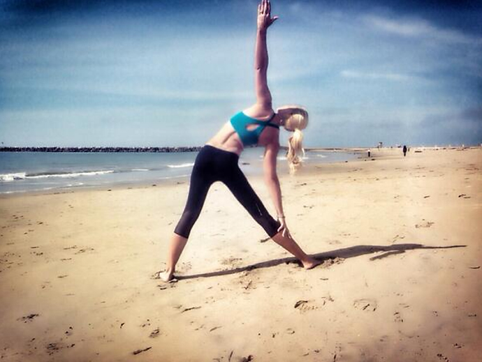 @natalie_gulbis                     Can't think of a better place to do yoga than the beach!