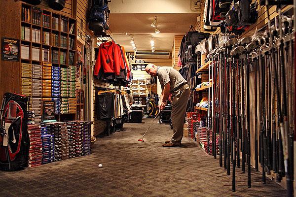 4:03 p.m., East 47th St. At World of Golf, Sean O'Sullivan rolls on.
