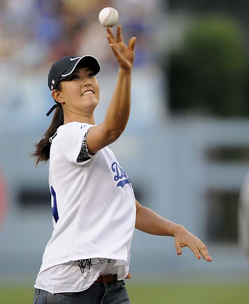 Michelle Wie throws out the first pitch at the start of a baseball game between the Atlanta Braves and the Los Angeles Dodgers, Saturday, Aug. 8, 2009, in Los Angeles.
