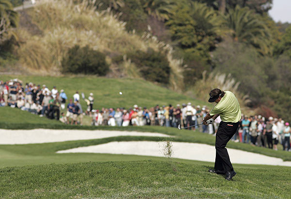Phil Mickelson did not back down during the final round of the Nissan Open, trying to send this shot over two bunkers.