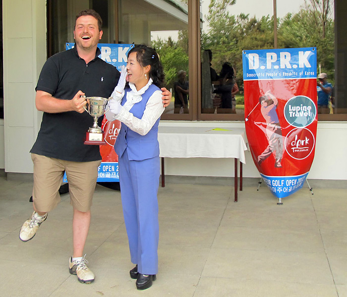 WE HAVE A WINNER: With the second North Korean Amateur Open in the books, the champion exalts.