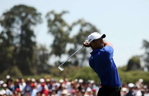 Tiger Woods leads by three shots over three players heading into the weekend.