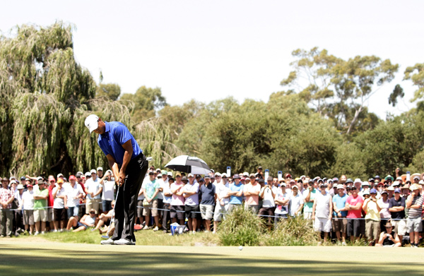 Woods made four birdies and no bogeys on Friday.
