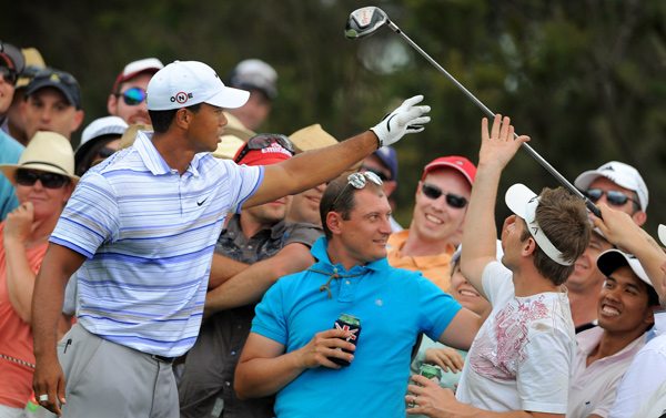 """After hitting a poor drive on No. 13, Woods slammed his driver to the ground and it bounced into the crowd. """"That was my mistake,"""" Woods said. """"I got hot after a bad tee shot and let go of the club."""""""