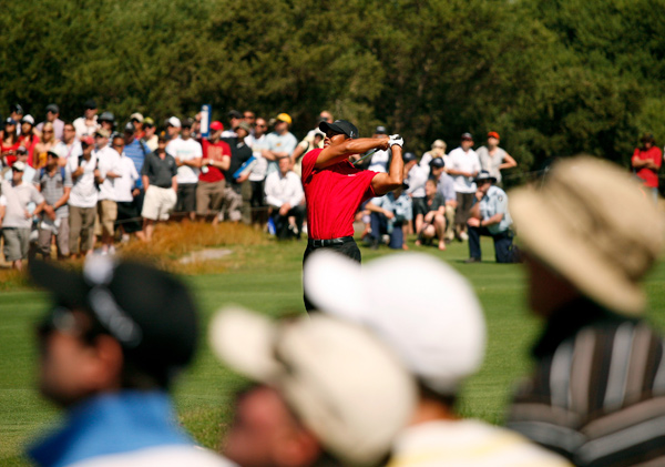 Tiger Woods won his seventh title of the year, closing with a 68 to win by two strokes.