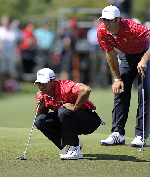 Tiger Woods and Dustin Johnson took on the all-Australian team of Jason Day and Aaron Baddeley on Day 2 at Royal Melbourne and lost, one down.