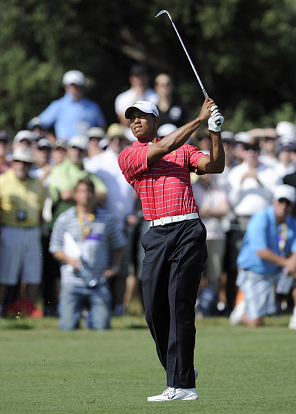 Woods missed a birdie putt at the first that would have won the hole.