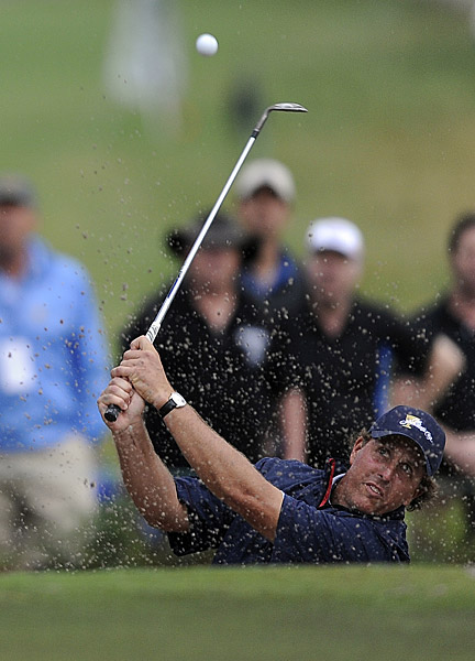 Phil Mickelson improved his stellar record at Royal Melbourne to 3-0, teaming again with Jim Furyk in a win over Aaron Baddeley and Jason Day.
