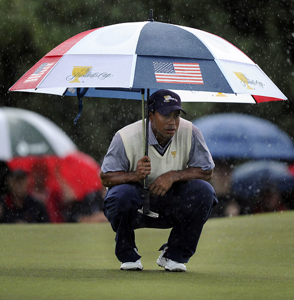 The Americans fought through the heavy rain to claim four of the five points available and take an 11-6 lead into the afternoon. Tiger Woods teamed with Dustin Johnson to win his first point of the week.