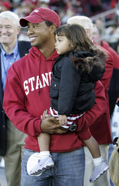 Tiger brought his daughter, Sam, to the game.